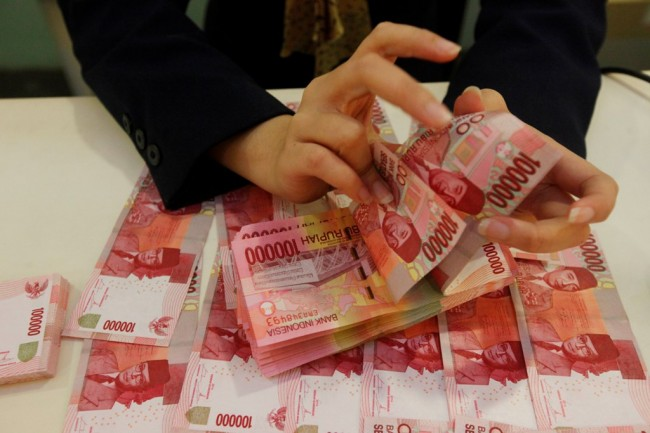 Rupiah Bergerak Negatif ke Posisi Rp13.928/USD
