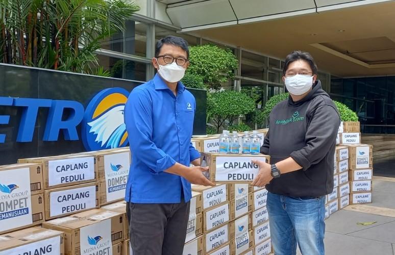 DK Media Group Terima Bantuan <i>Hand Sanitizer</i> dari Cap Lang