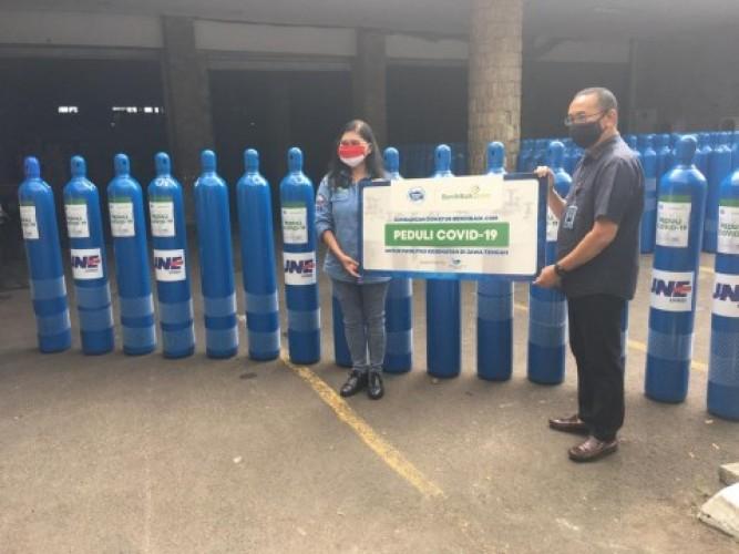 DKMG Salurkan Susu UHT dan Tabung Oksigen dari Frisian Flag