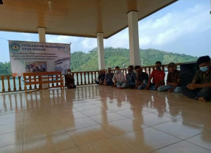 Dosen Unila Dampingi Masyarakat Desa Kiluan Negeri dengan Pengolahan Ikan Asap