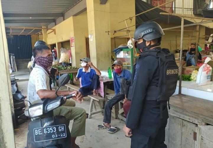 Kompi 3 B Pelopor Satbrimob Patroli Dialogis di Wilayah Menggala