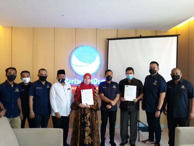 NasDem Serahkan Surat Persetujuan Parpol untuk Eva-Dedi dan Nasir-Naldi