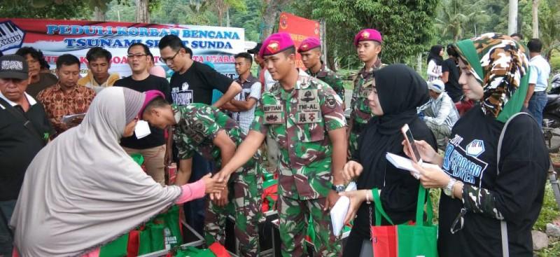 Prajurit Yonif 9 Marinir Bersama KKJU Berikan Bantuan untuk Korban Tsunami