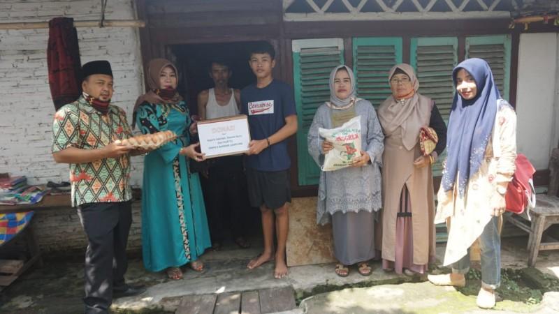 SMPN 5 Bandar Lampung Bantu Keluarga Siswa Terdampak Korona dan Banjir