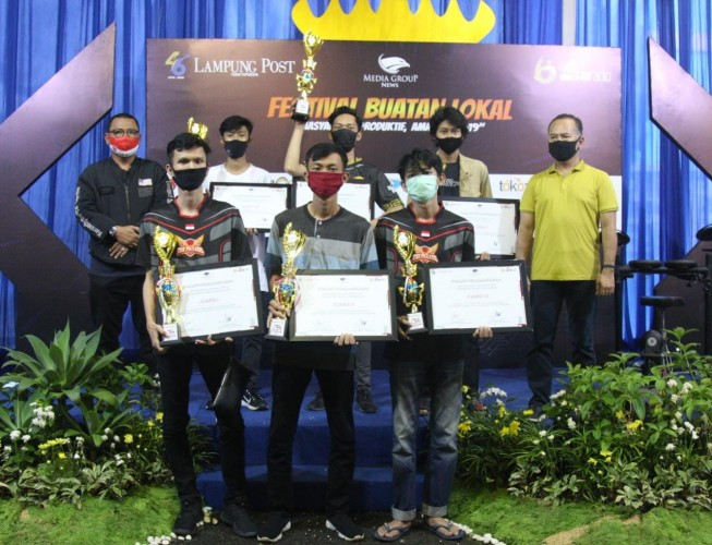 Squad Instinct dan Eightnine King Juarai <i>eSport</i> HUT ke-46 Lampung Post