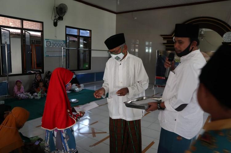 TPMAl Ikhlas GelarKurban dan Santuni Yatim Piatu