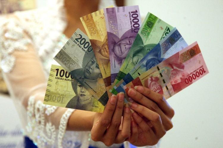 Uang Rupiah Distempel Tak Layak Edar