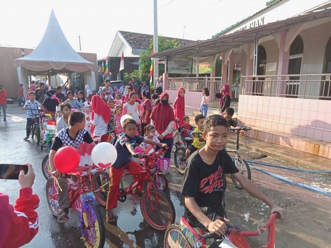 Warga Imopuro Meriahkan HUT RI dengan Jalan Sehat dan Sepeda Hias